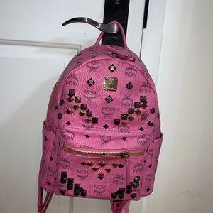Pink MCM studded book bag